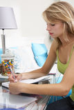 Teenage Girl Writing In Diary Royalty Free Stock Images