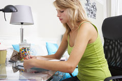 Teenage Girl Writing In Diary Royalty Free Stock Image