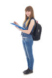 Teenage girl writing in notebook isolated on white Royalty Free Stock Photo