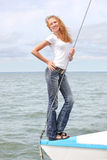Teenage girl in yacht. Yong smiling girl on the boad Stock Photography