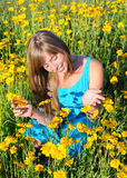 Teenage   girl among the yellow flowers Royalty Free Stock Photography