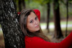 Teenage Girl. Young teenage girl leaning against a tree in the park Royalty Free Stock Photography