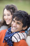Teenage girl and young man smiling. Teenage girl and young men smiling Royalty Free Stock Images