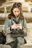 Teenage girl / young student looking at her smartphone - close shot Royalty Free Stock Photo