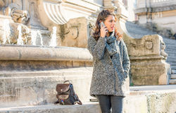 Teenage girl / young student talking on the phone Stock Photography
