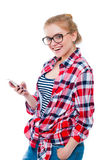 Teenage girl or young woman in glasses with cell phone laughing Stock Images