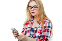 Teenage girl or young woman in glasses with cell phone Royalty Free Stock Photo