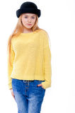 Teenage girl or young woman in yellow sweater and black hat look Royalty Free Stock Images