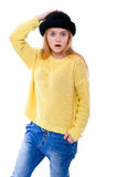 Teenage girl or young woman in yellow sweater and black hat look Royalty Free Stock Photos