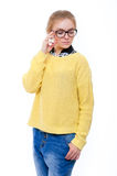 Teenage girl or young woman in yellow sweater and glasses Stock Photos