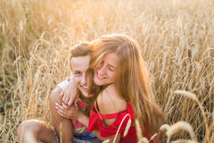 Teenage girlfriend and boyfriend having fun outdoors, kissing, hugging, love concept. Royalty Free Stock Photography