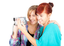 Teenage girlfriend with video camera Stock Images