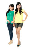 Teenage girls. Portrait of attractive asian teenage girls pose  on white background Stock Photography