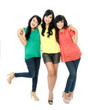 Teenage girls. Portrait of attractive three teenage girls hugging each other  on white background Royalty Free Stock Photo