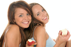 Teenage girls with apples. Smiling Royalty Free Stock Photos