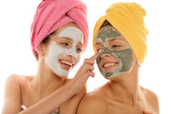 Teenage girls applying facial cream Royalty Free Stock Images