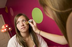 Teenage girls applying makeup Stock Image