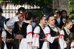 Girls in traditional costumes of Vojvodina, Serbia attending the parade royalty free stock photo