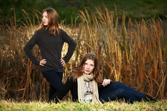 Teenage girls in autumn park Royalty Free Stock Photography