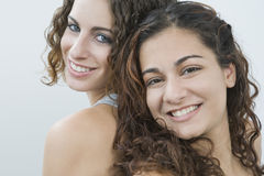 Teenage girls back to back Royalty Free Stock Images