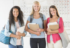 Teenage Girls With Backpacks And Books In Chemistry Class stock photography