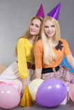 Teenage girls with balloons at a birthday party Stock Photos