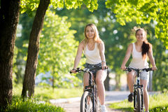 Teenage girls on bicycle ride Royalty Free Stock Photo