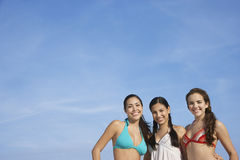 Teenage Girls In Bikinis Standing Against Sky Stock Image