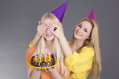 Teenage girls with birthday cake Royalty Free Stock Image