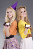 Teenage girls with birthday cakes Stock Photography