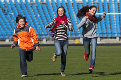 Teenage girls and boy enjoy to running Stock Photos