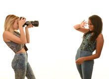 Teenage girls with camera Stock Photography