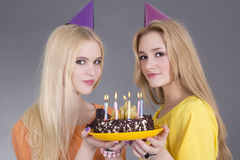 Teenage girls with chochlate birthday cake Royalty Free Stock Images