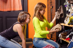 Teenage girls choosing clothes. From the wardrobe Stock Photos