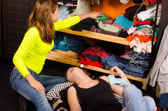 Teenage girls choosing clothes Stock Photo
