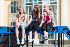 Happy teen girls on city street Royalty Free Stock Image