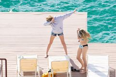 Teenage girls dabbing on a dock royalty free stock photo