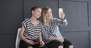 Teenage girls doing video chat on mobile phone. Teenage girls having fun while doing video chat using mobile phone stock video footage