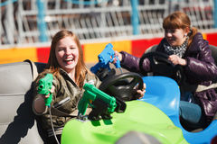 Teenage girls driving a bumper cars Stock Image