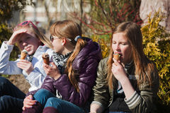 Teenage girls eating an ice cream Royalty Free Stock Image