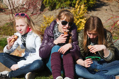 Teenage girls eating an ice cream Stock Images