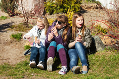 Teenage girls eating an ice cream Stock Images