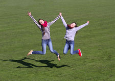 Teenage girls enjoy to jumping Royalty Free Stock Image