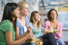 Teenage girls enjoying healthy lunches together Stock Photo