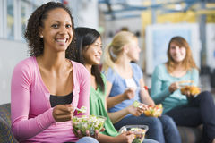 Teenage girls enjoying healthy lunches together Royalty Free Stock Photos
