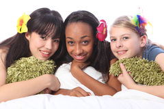 Teenage girls flowers in hair at sleepover party Stock Photography