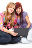 Teenage girls friends with laptop Stock Image
