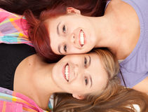 Teenage girls friends lying head to head Royalty Free Stock Photo