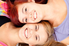 Teenage girls friends lying head to head Royalty Free Stock Photos