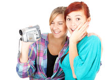 Teenage girls friends with video camera Royalty Free Stock Photography